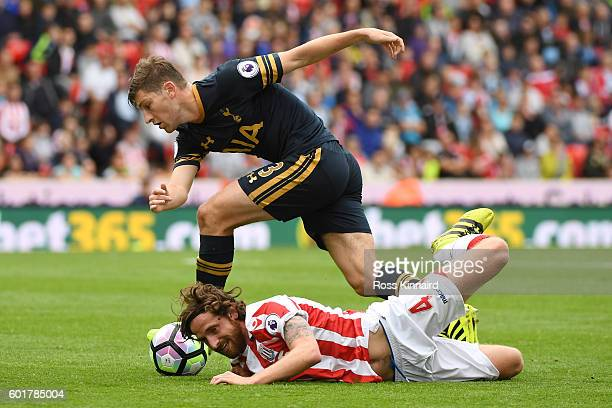 Joe Allen of Stoke City is fouled by Ben Davies of Tottenham Hotspur during the Premier League match between Stoke City and Tottenham Hotspur at...