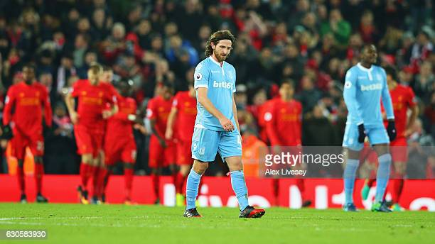 Joe Allen of Stoke City looks dejected as Gianelli Imbula of Stoke City scores an own goal for Liverpool's third during the Premier League match...
