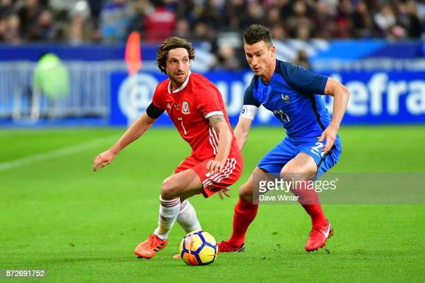 Joe Allen of Wales and Laurent Koscielny of France during the international friendly match between France and Wales at Stade de France on November 10...