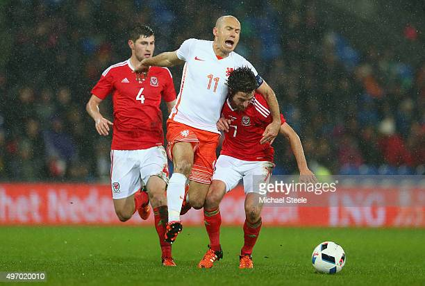 Joe Allen of Wales is challenged by Arjen Robben of Netherlands during the international friendly match between Wales and Netherlands at Cardiff City...