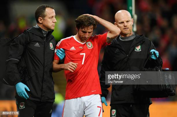 Joe Allen of Wales is given assistance as he injures his head during the FIFA 2018 World Cup Group D Qualifier between Wales and Republic of Ireland...