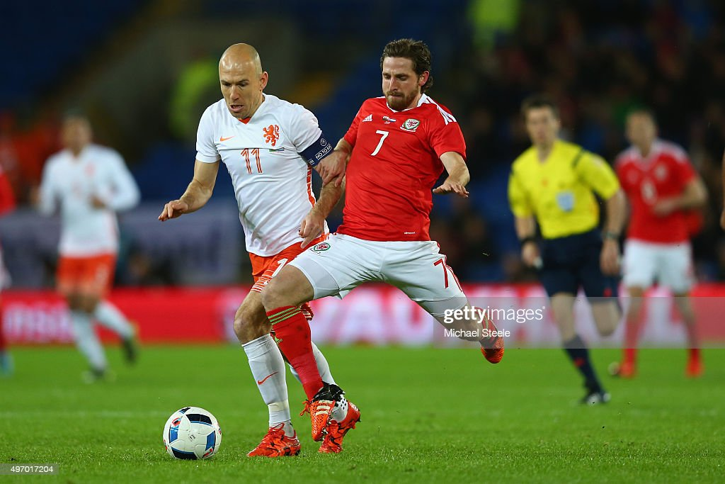 Joe Allen of Wales wins the ball from Arjen Robben of Netherlands during the international friendly match between Wales and Netherlands at Cardiff City Stadium on November 13, 2015 in Cardiff, Wales.