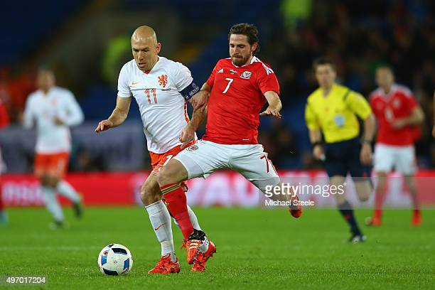 Joe Allen of Wales wins the ball from Arjen Robben of Netherlands during the international friendly match between Wales and Netherlands at Cardiff...