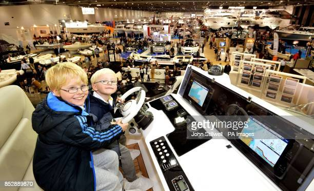 Joe and brother Teddy West try the view from the Bridge of a British built Sunseeker luxury Yacht on the first day of the London Boat show 2014 at...