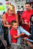 Joe and Julie Jimenez of Carpinteria shop for their four children including Joseph 7 who tries on a jacket at Walmart in Oxnard Joe says they can buy...