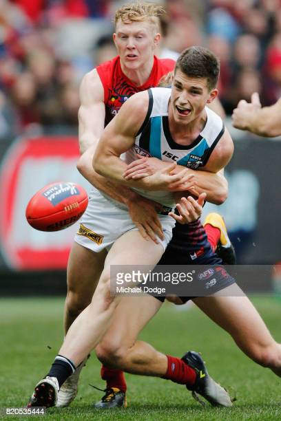 Joe Atley of the Power is tackled by Jayden Hunt of the Demons during the round 18 AFL match between the Melbourne Demons and the Port Adelaide Power...