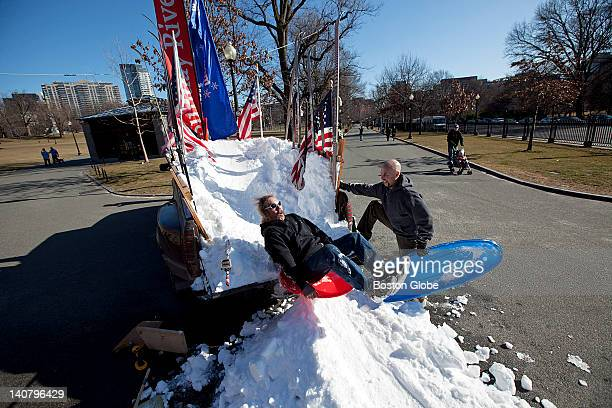 Joe Bailey sleds off of the mound of snow brought from Bethel Maine with friend Barry Hallet Jr in Boston Common Hallet is issued a $40 ticket from a...