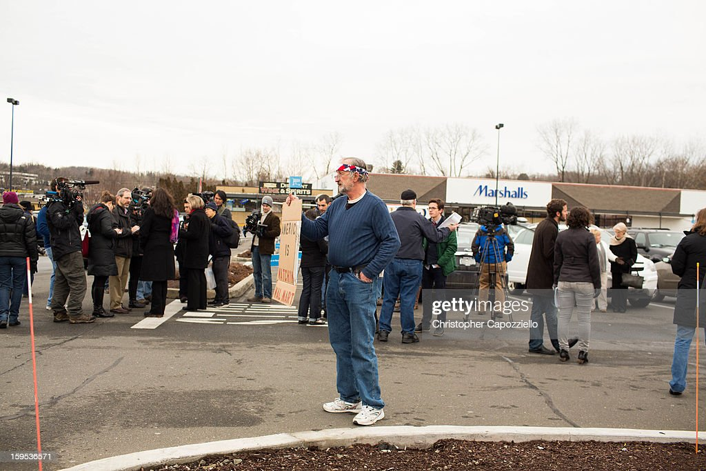 Joe Barbarito, of Rifton, New York., joins protestors outside the Danbury Walmart January 15, 2013 in Danbury, Connecticut. Gun control advocates along with parents of victims and gun violence survivors joined together to urge Walmart, the nation's largest gun retailer to stop the sale of assault weapons and munitions in their stores nationwide.