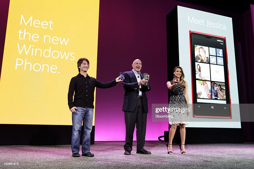Joe Belfiore, vice president at Microsoft Corp., from left, <a gi-track='captionPersonalityLinkClicked' href=/galleries/search?phrase=Steve+Ballmer&family=editorial&specificpeople=211258 ng-click='$event.stopPropagation()'>Steve Ballmer</a>, chief executive officer of Microsoft, and actress <a gi-track='captionPersonalityLinkClicked' href=/galleries/search?phrase=Jessica+Alba&family=editorial&specificpeople=201811 ng-click='$event.stopPropagation()'>Jessica Alba</a> speak at an event to unveil Windows Phone 8 software in San Francisco, California, U.S., on Monday, Oct. 29, 2012. Microsoft Corp. unveiled a new version of its software for smartphones today, redoubling an effort to regain market share lost to Apple Inc. and Google Inc. Photographer: Tony Avelar/Bloomberg via Getty Images