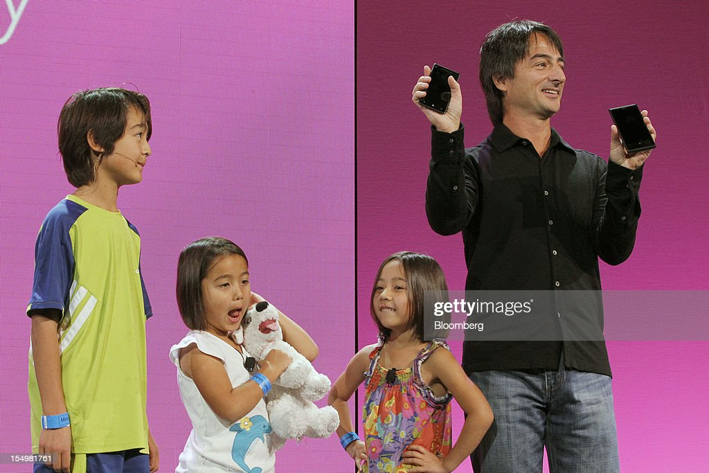 Joe Belfiore, vice president at Microsoft Corp., right, is accompanied by his children as he speaks about the Kid's Corner feature of Windows Phone 8 software in San Francisco, California, U.S., on Monday, Oct. 29, 2012. Microsoft Corp. unveiled a new version of its software for smartphones today, redoubling an effort to regain market share lost to Apple Inc. and Google Inc. Photographer: Tony Avelar/Bloomberg via Getty Images