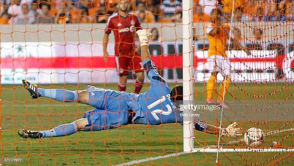 Joe Bendik #12 of Toronto FC dives for the ball as it goes wide against the Houston Dynamo at BBVA Compass Stadium on June 22, 2013 in Houston, Texas.