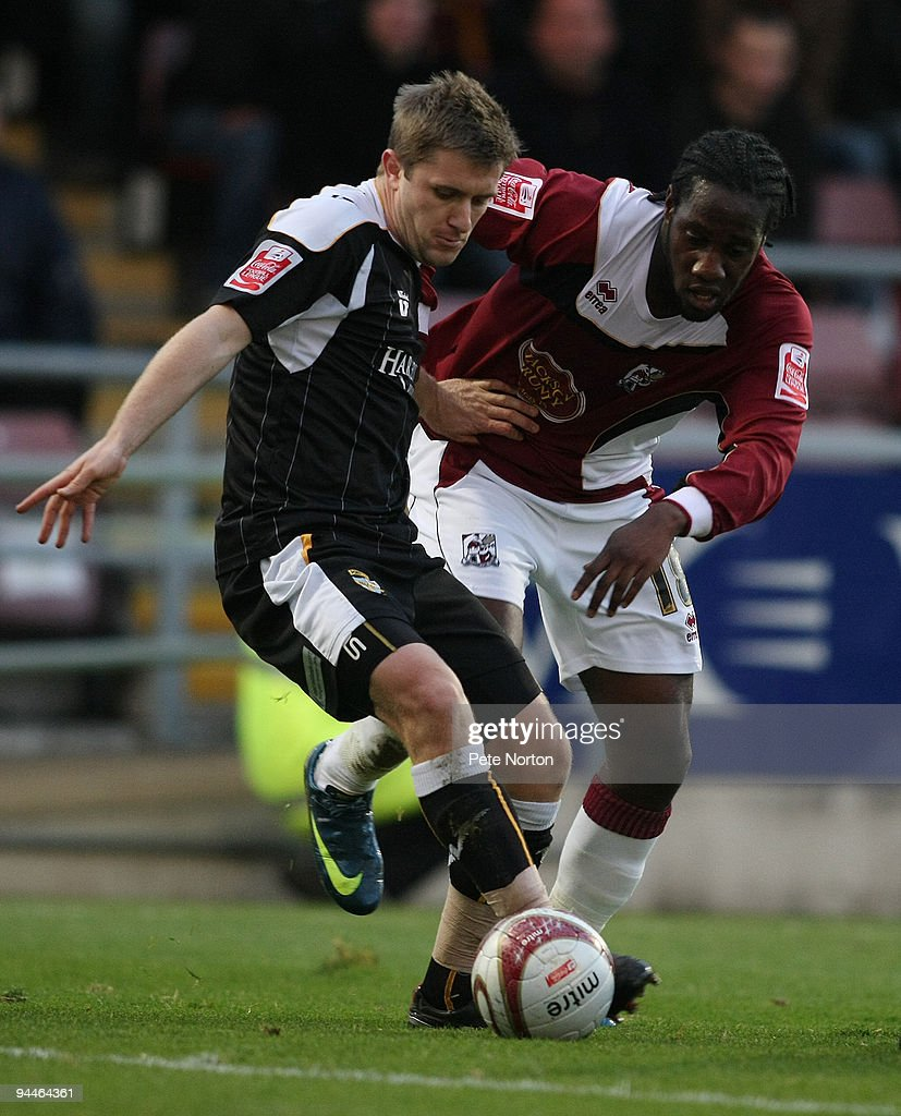 Joe Benjamin of Northampton Town and Adam Yates of Port Vale contest the ball during the Coca Cola League Two Match between Northampton Town and Port Vale at Sixfields Stadium on December 12, 2009 in Northampton, England.