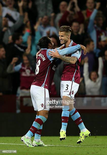 Joe Bennett of Aston Villa celebrates scoring his team's fifth goal with Kieran Richardson during the Capital One Cup second round match between...