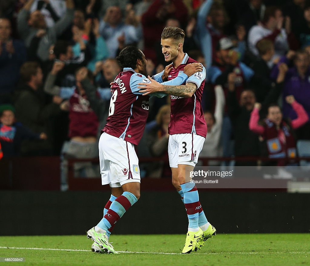 Joe Bennett (R) of Aston Villa celebrates scoring his team's fifth goal with Kieran Richardson during the Capital One Cup second round match between Aston Villa and Notts County at Villa Park on August 25, 2015 in Birmingham, England.