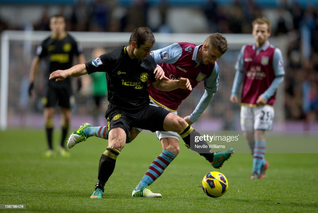 Joe Bennett of Aston Villa challenges Shaun Maloney of Wigan Athletic during the Barclays Premier League match between Aston Villa and Wigan Athletic at Villa Park on December 29, 2012 in Birmingham, England.