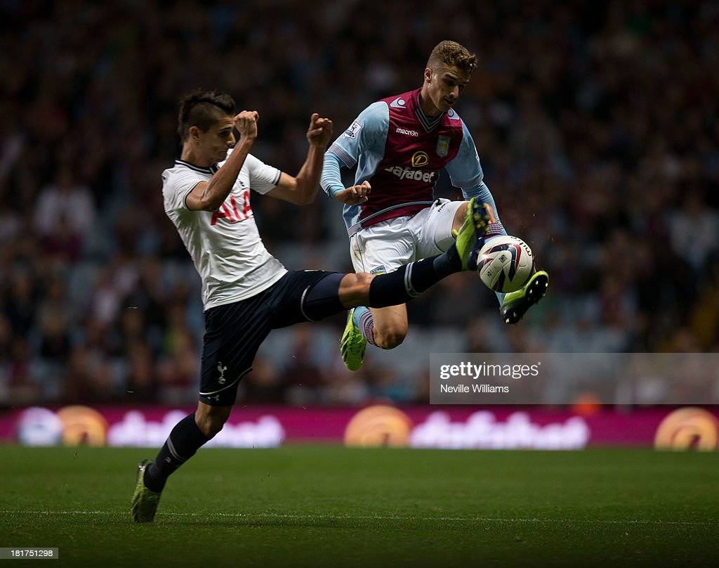 Joe Bennett of Aston Villa is challenged by Erik Lamela of Tottenham Hotspur during the Capital One Cup Third Round match between Aston Villa and Tottenham Hotspur at Villa Park on September 24, 2013 in Birmingham, England.