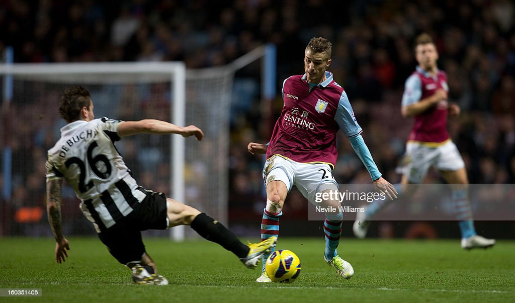 Joe Bennett of Aston Villa is challenged by <a gi-track='captionPersonalityLinkClicked' href=/galleries/search?phrase=Mathieu+Debuchy&family=editorial&specificpeople=729104 ng-click='$event.stopPropagation()'>Mathieu Debuchy</a> of Newcastle United during the Barclays Premier League match between Aston Villa and Newcastle United at Villa Park on January 29, 2013 in Birmingham, England.