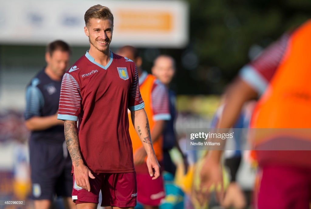 Joe Bennett of Aston Villa smiles before the pre season friendly match between Mansfield Town and Aston Villa at the One Call Stadium on July 17, 2014 in Mansfield, England.