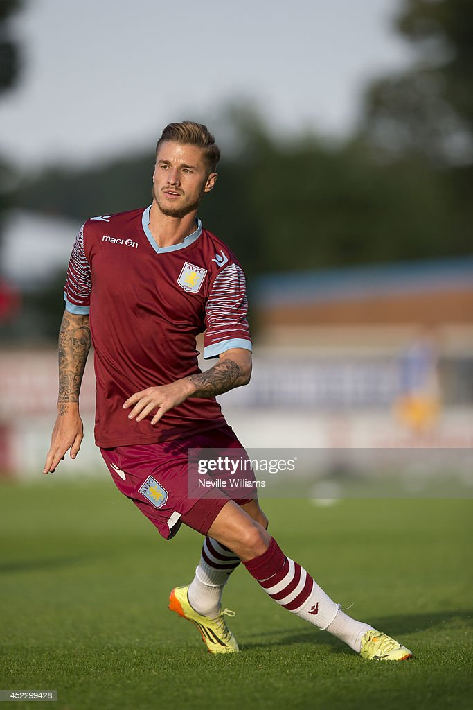 Joe Bennett of Aston Villa warms up before the pre season friendly match between Mansfield Town and Aston Villa at the One Call Stadium on July 17, 2014 in Mansfield, England.