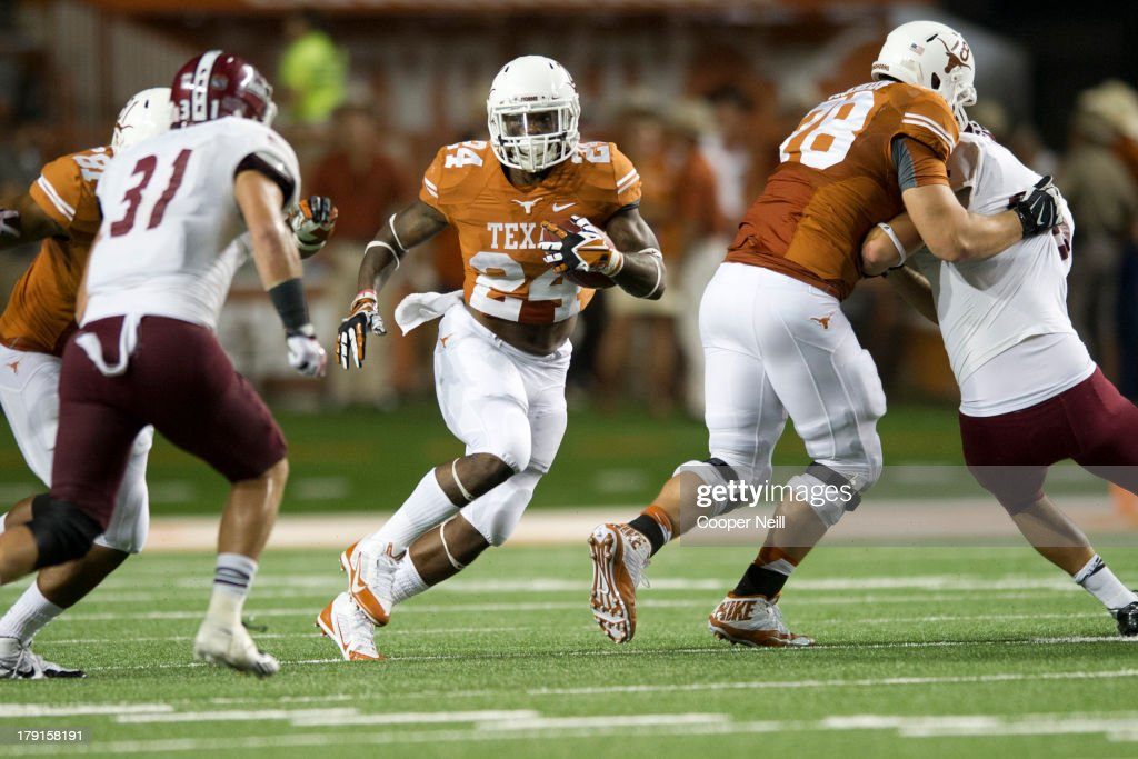 Joe Bergeron #24 of the Texas Longhorns breaks free against the New Mexico State Aggies on August 31, 2013 at Darrell K Royal-Texas Memorial Stadium in Austin, Texas.