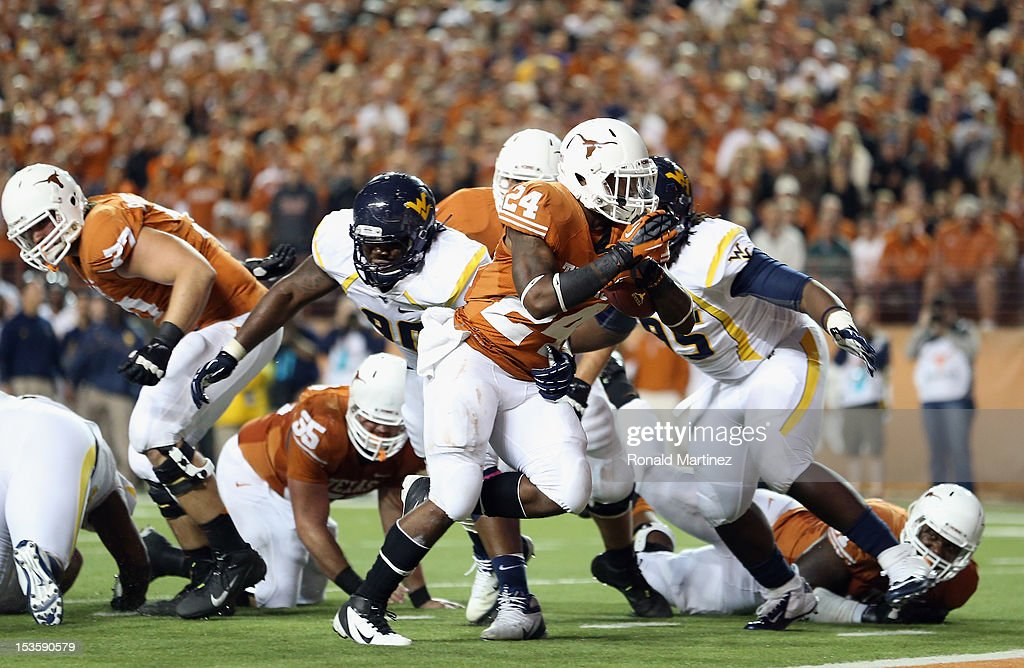 Joe Bergeron #24 of the Texas Longhorns runs for a touchdown against the West Virginia Mountaineers at Darrell K Royal-Texas Memorial Stadium on October 6, 2012 in Austin, Texas.