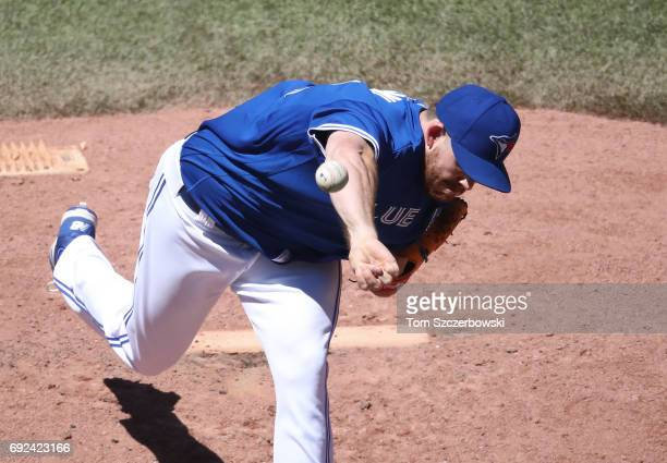 Joe Biagini of the Toronto Blue Jays delivers a pitch in the fifth inning during MLB game action against the New York Yankees at Rogers Centre on...
