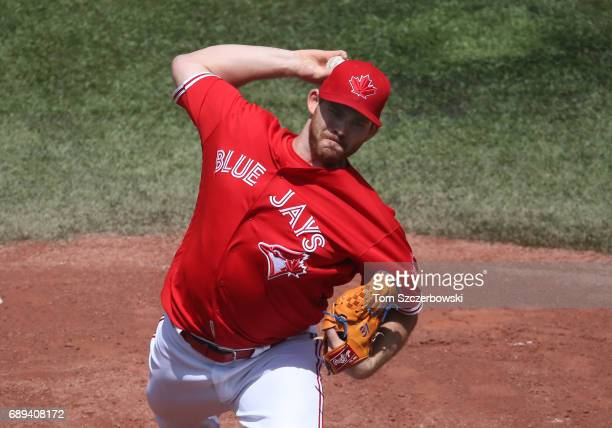 Joe Biagini of the Toronto Blue Jays delivers a pitch in the first inning during MLB game action against the Texas Rangers at Rogers Centre on May 28...