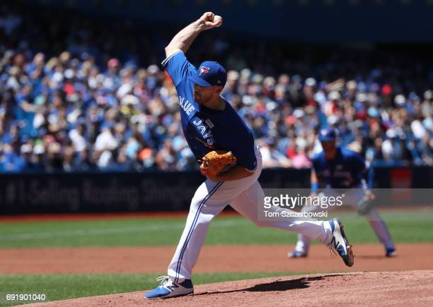 Joe Biagini of the Toronto Blue Jays delivers a pitch in the first inning during MLB game action against the New York Yankees at Rogers Centre on...