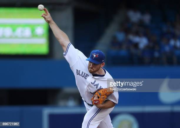 Joe Biagini of the Toronto Blue Jays delivers a pitch in the first inning during MLB game action against the Chicago White Sox at Rogers Centre on...