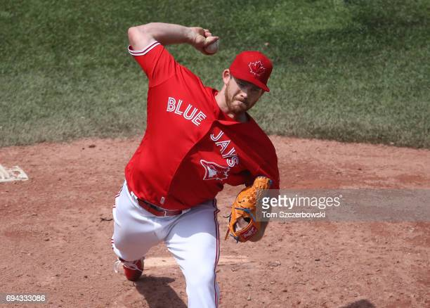 Joe Biagini of the Toronto Blue Jays delivers a pitch in the sixth inning during MLB game action against the Texas Rangers at Rogers Centre on May 28...
