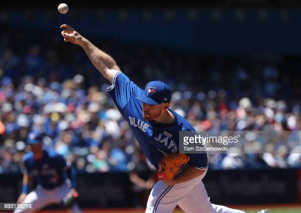 Joe Biagini of the Toronto Blue Jays delivers a pitch in the third inning during MLB game action against the New York Yankees at Rogers Centre on...