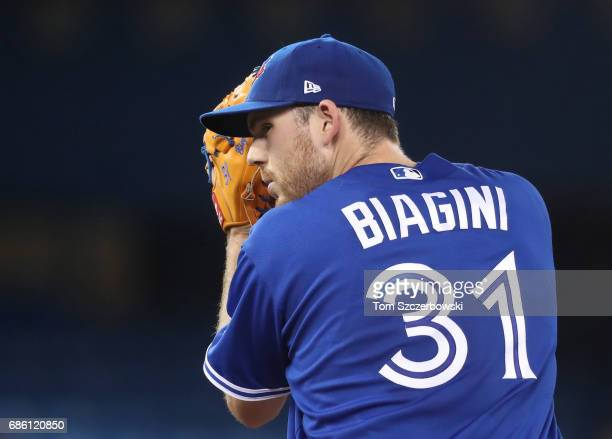 Joe Biagini of the Toronto Blue Jays looks in before delivering a pitch in the fifth inning during MLB game action against the Seattle Mariners at...