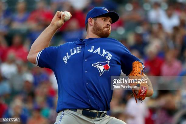 Joe Biagini of the Toronto Blue Jays pitches against the Texas Rangers in the bottom of the first inning at Globe Life Park in Arlington on June 21...