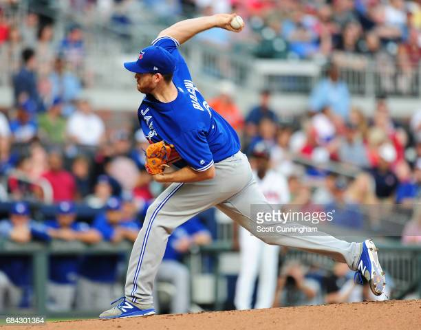Joe Biagini of the Toronto Blue Jays throws a first inning pitch against the Atlanta Braves at SunTrust Park on May 17 2017 in Atlanta Georgia
