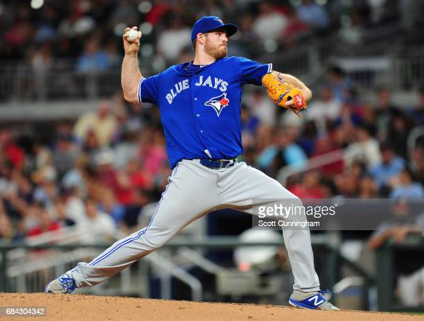 Joe Biagini of the Toronto Blue Jays throws a fourth inning pitch against the Atlanta Braves at SunTrust Park on May 17 2017 in Atlanta Georgia