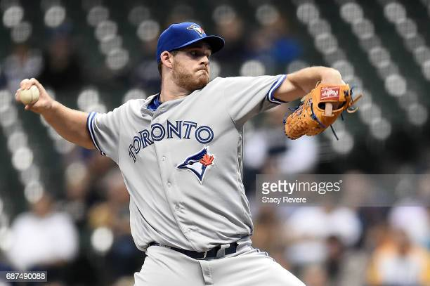 Joe Biagini of the Toronto Blue Jays throws a pitch during the first inning of a game against the Milwaukee Brewers at Miller Park on May 23 2017 in...