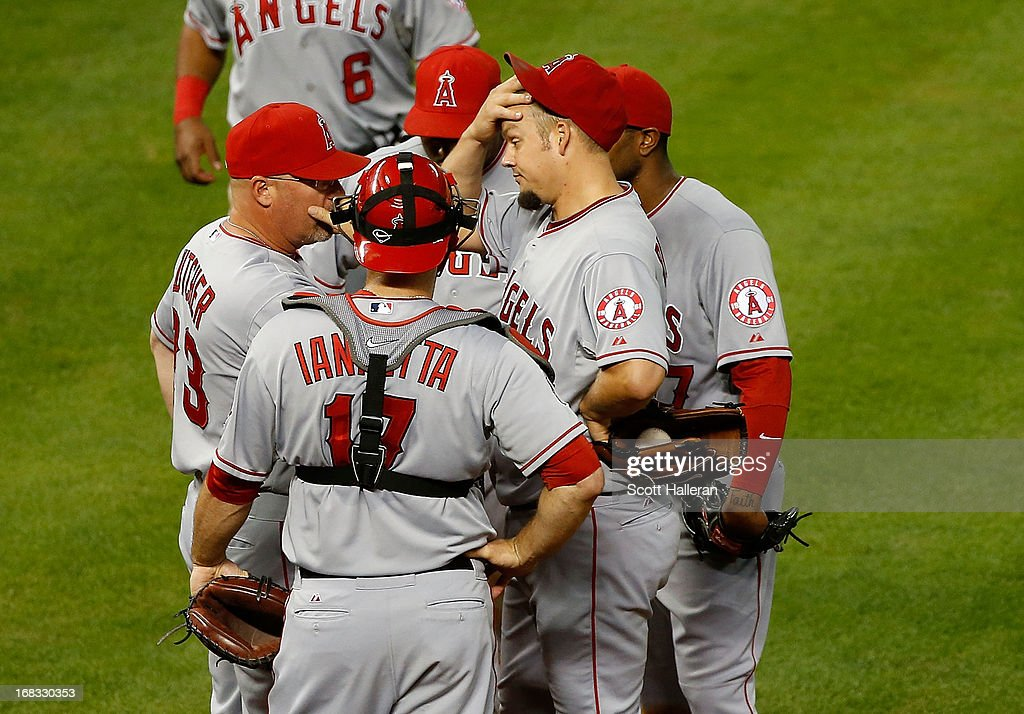 Joe Blanton #55 (C) of the Los Angeles Angels of Anaheim chats with his pitching coach Mike Butcher #23 in the seventh inning against the Houston Astros at Minute Maid Park on May 8, 2013 in Houston, Texas.