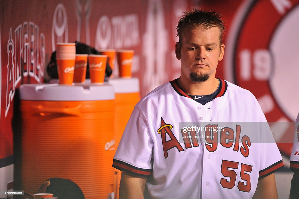 Joe Blanton #55 of the Los Angeles Angels of Anaheim reacts in the dugout after giving up two consecutive home runs in the eighth inning during a game against the Houston Astros at Angel Stadium of Anaheim on August 16, 2013 in Anaheim, California.