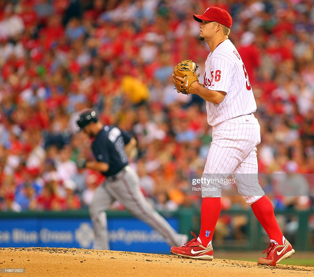 Joe Blanton #56 of the Philadelphia Phillies walks back on the mound as <a gi-track='captionPersonalityLinkClicked' href=/galleries/search?phrase=Brian+McCann+-+Baseball+Player&family=editorial&specificpeople=593065 ng-click='$event.stopPropagation()'>Brian McCann</a> #16 the Atlanta Braves rounds the bases after hitting a home run in the first inning during a MLB baseball game on July 7, 2012 at Citizens Bank Park in Philadelphia, Pennsylvania.