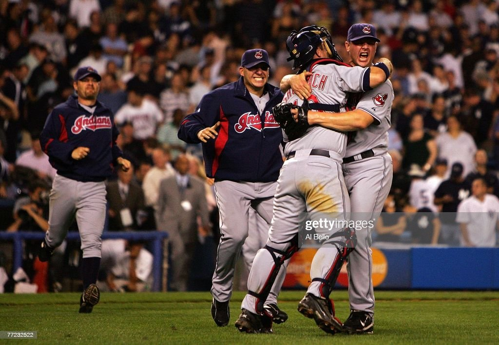 Joe Borowski and Kelly Shoppach of the Cleveland Indians celebrate after defeating the New York Yankees by the score of 64 to win the American League...