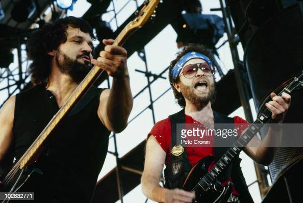 Joe Bouchard and Eric Bloom of Blue Oyster Cult perform on stage in 1984