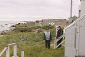 Joe Braach headmaster of Shishmaref school and friend stand outside his house on Shishmaref looking at how close the sea has moved to his house When...