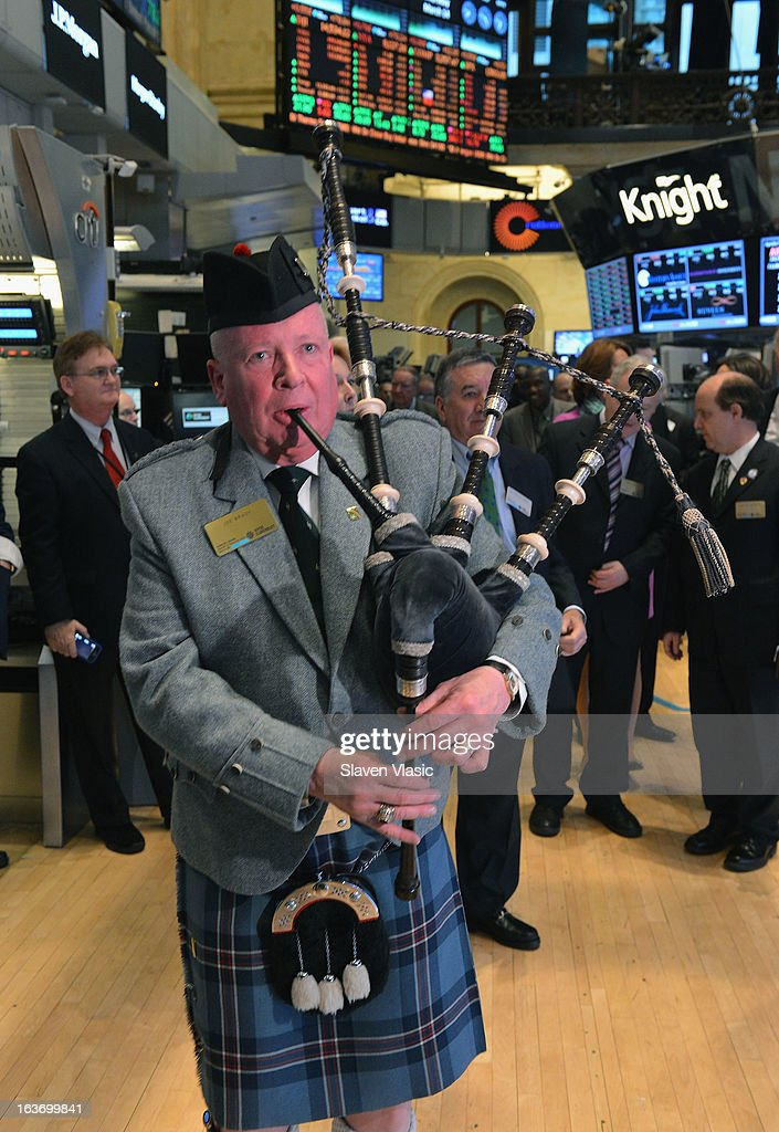 Joe Brady plays the bag pipes at the trading floor of the New York Stock Exchange in honor of St. PatrickÕs Day on March 14, 2013 in New York City.