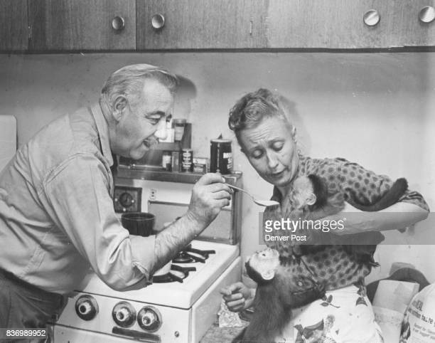 Joe Brand who decided as a Bridegroom 20 years ago that Eva was 'a worse cook than her mother' tries a spoon of his sauce on Natu Noco waits his turn...