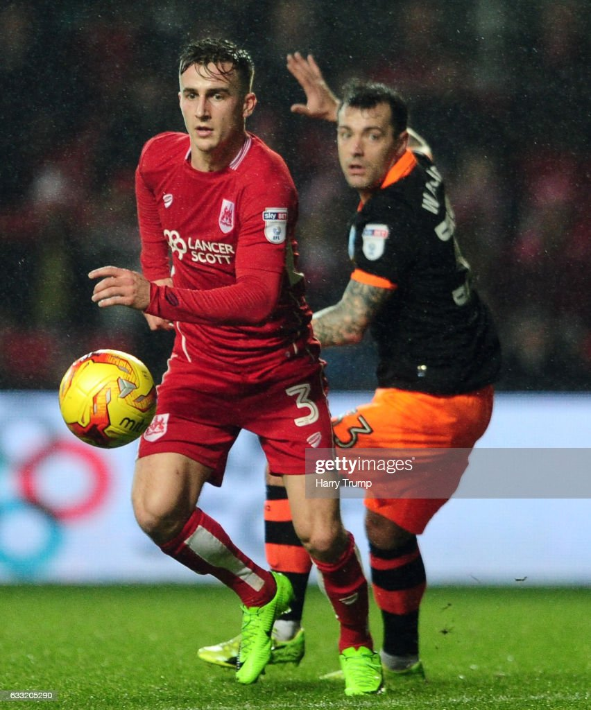 Joe Bryan of Bristol City is tackled by Ross Wallace of Sheffield Wednesday during the Sky Bet Championship match between Bristol City and Sheffield Wednesday at Ashton Gate on January 31, 2017 in Bristol, England.