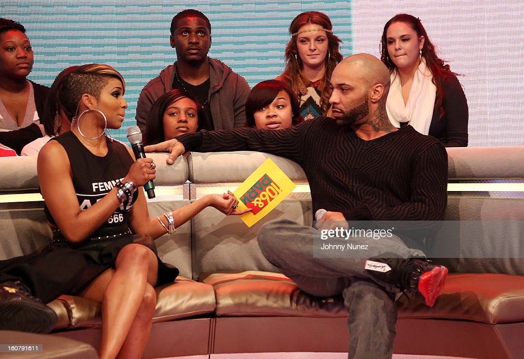 Joe Budden (R) visits BET's '106 & Park' with host Ms. Mykie (L) at BET Studios on February 5, 2013 in New York City.
