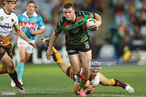 Joe Burgess of the Rabbitohs beats the tackle of Ben Hunt of the Broncos during the round 19 NRL match between the South Sydney Rabbitohs and the...
