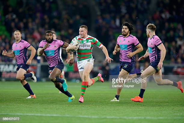 Joe Burgess of the Rabbitohs breaks through the defence during the round 22 NRL match between the Melbourne Storm and the South Sydney Rabbitohs at...