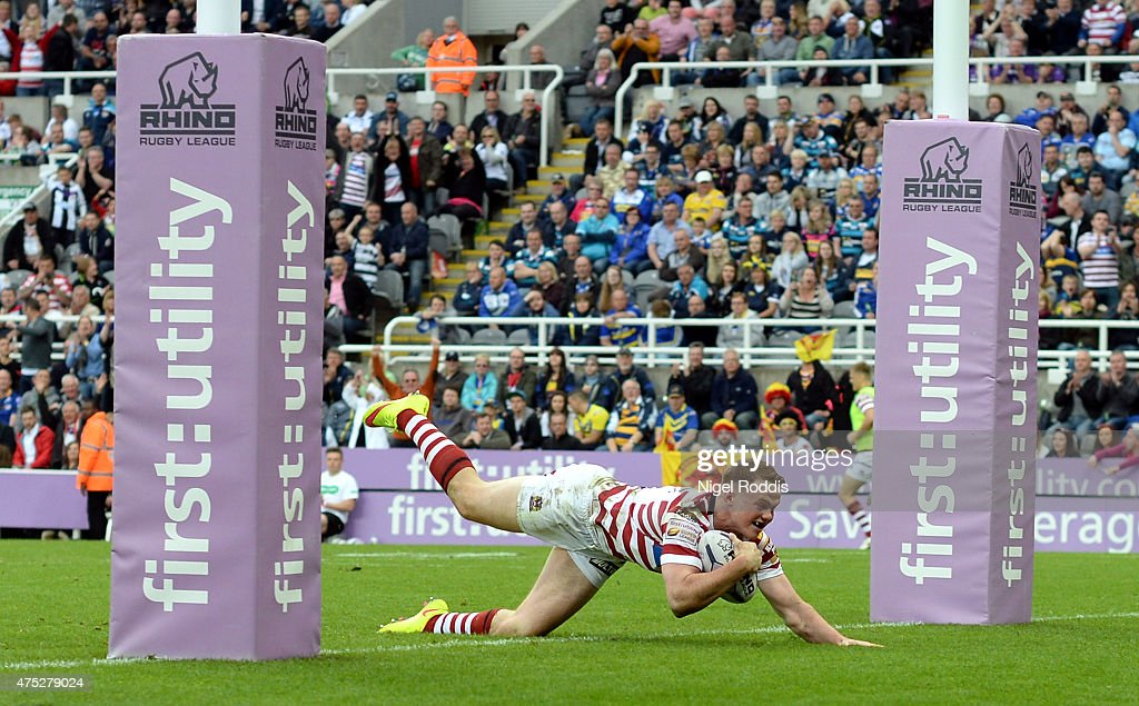 Joe Burgess of Wigan Warriors scores a try during the Super League match between Leeds Rhinos and Wigan Warriors at St James' Park on May 30 2015 in...
