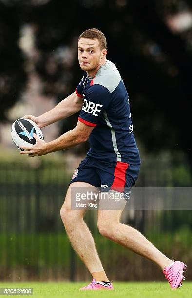 Joe Burgess passes during a Sydney Roosters NRL training session at Moore Park on April 12 2016 in Sydney Australia